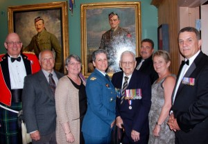 Members of the family of LTCol C E Bent pose in front of his portrait during the Annual Officer's Mess Dinner of the 48th Highlanders of Canada in Toronto. May 2012.