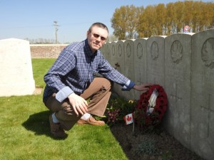 Robert Lindsay of Belfast lays a commemorative wreath at the grave of his grandfather Pte Robert Lindsay who was killed in action with the 15th Battalion On 9 April 2017.